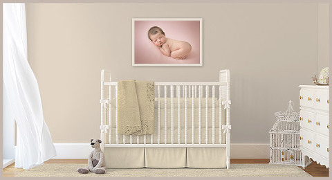 A framed 20x30 Gallery Wrap hanging in the nursery