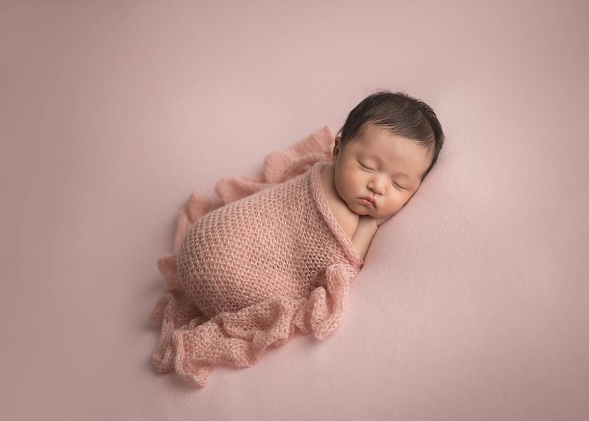 Adorable newborn girl sleeping