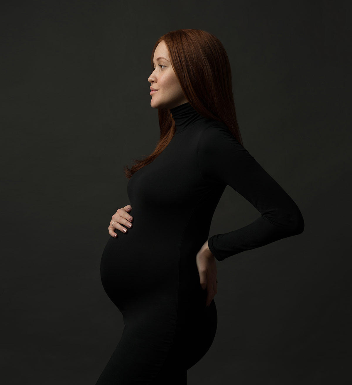 Black bodysuit on a pregnant woman with red hair