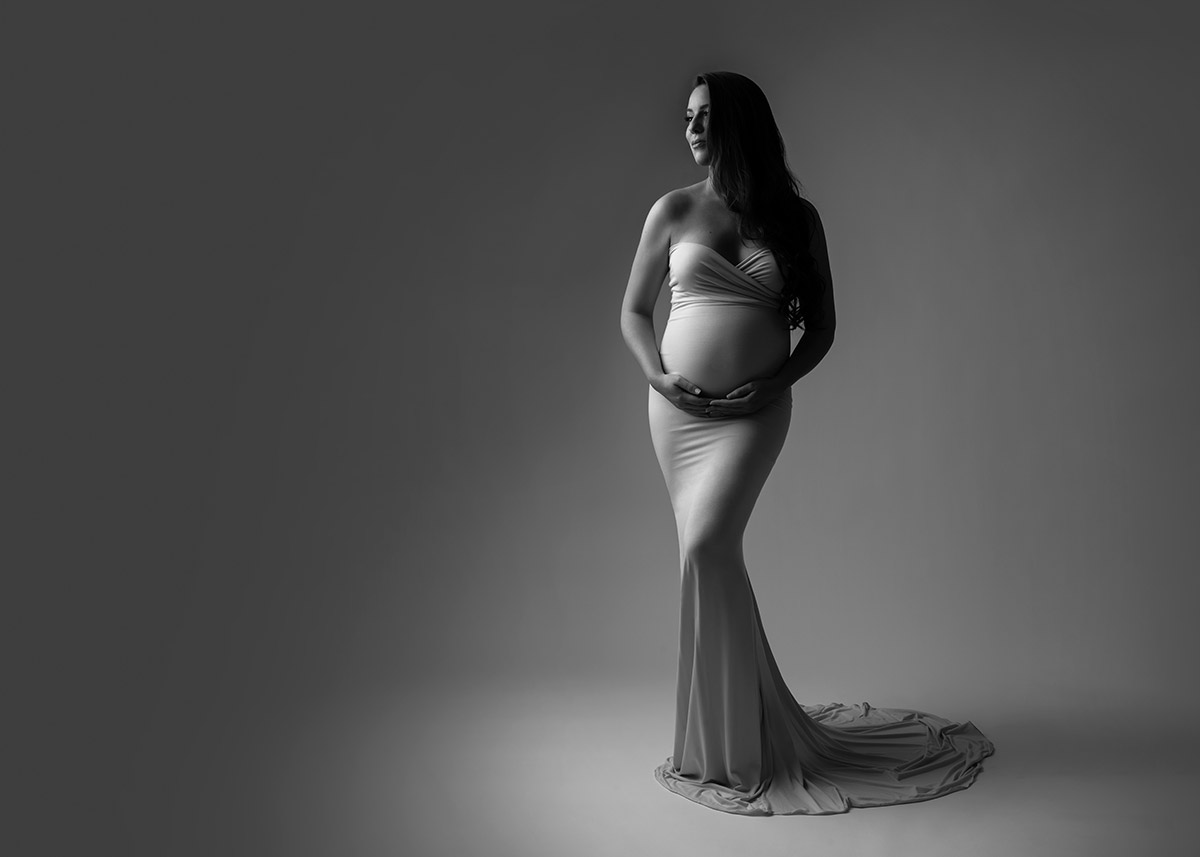 Maternity portrait of a woman wearing a dress