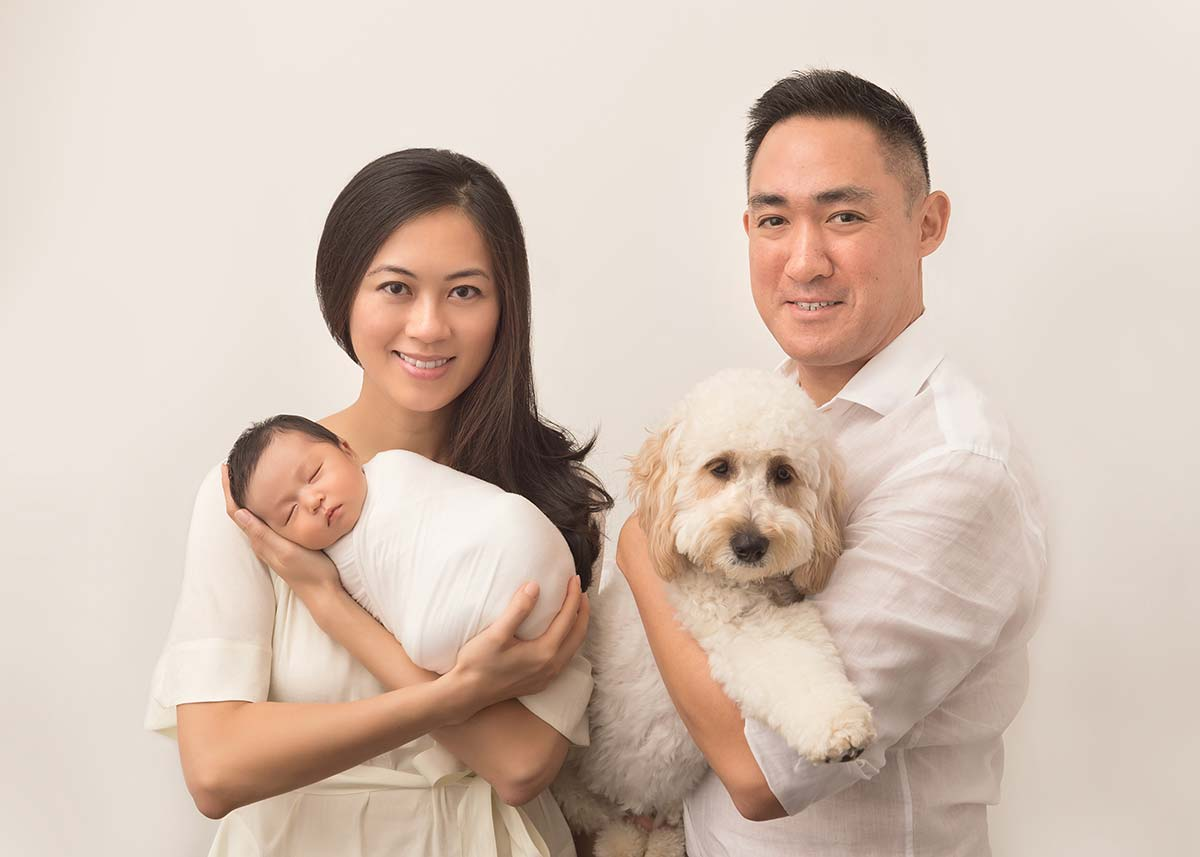 Family photo with a pet and a newborn baby