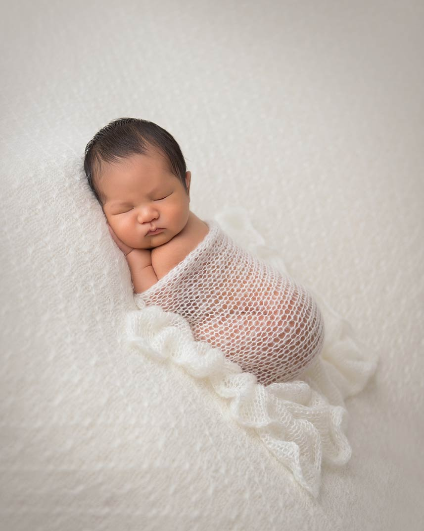 Photo of a sleeping newborn baby taken at a NYC photography studio