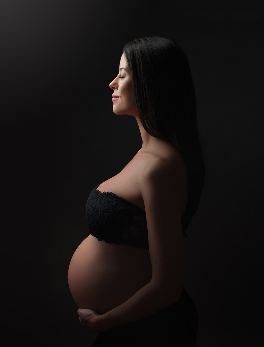 Profile angle of a pregnant woman in a photo studio NYC