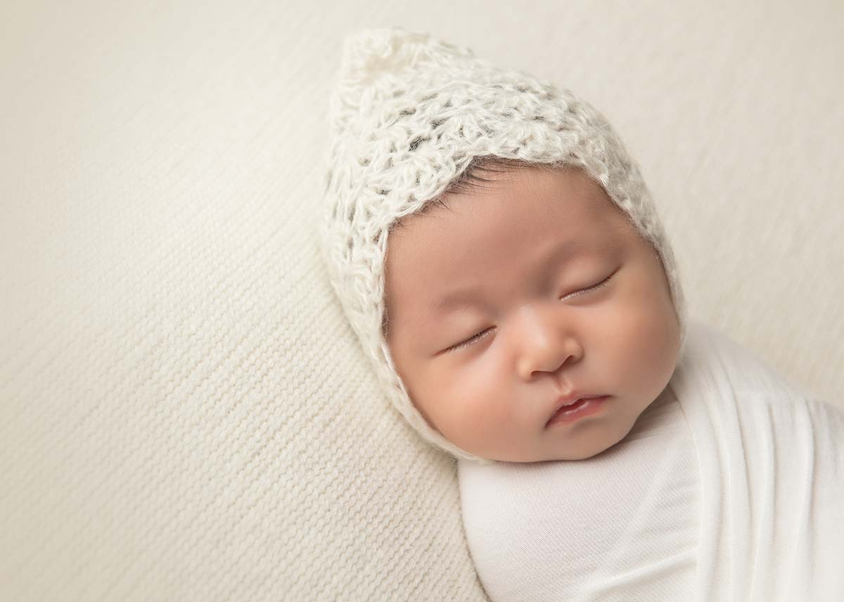 Cute newborn baby pose with a hat