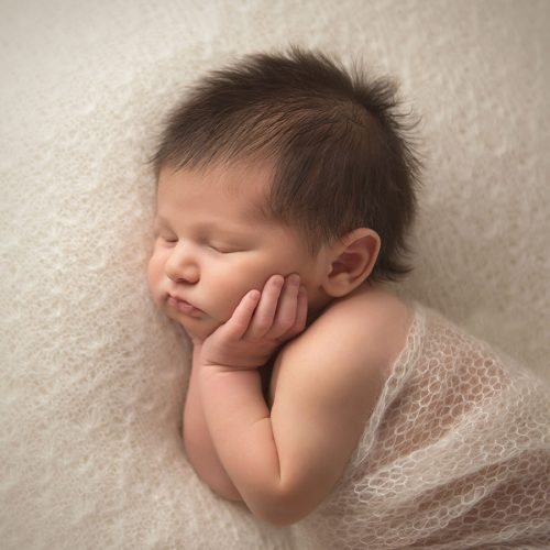 Newborn photo of a sleeping infant