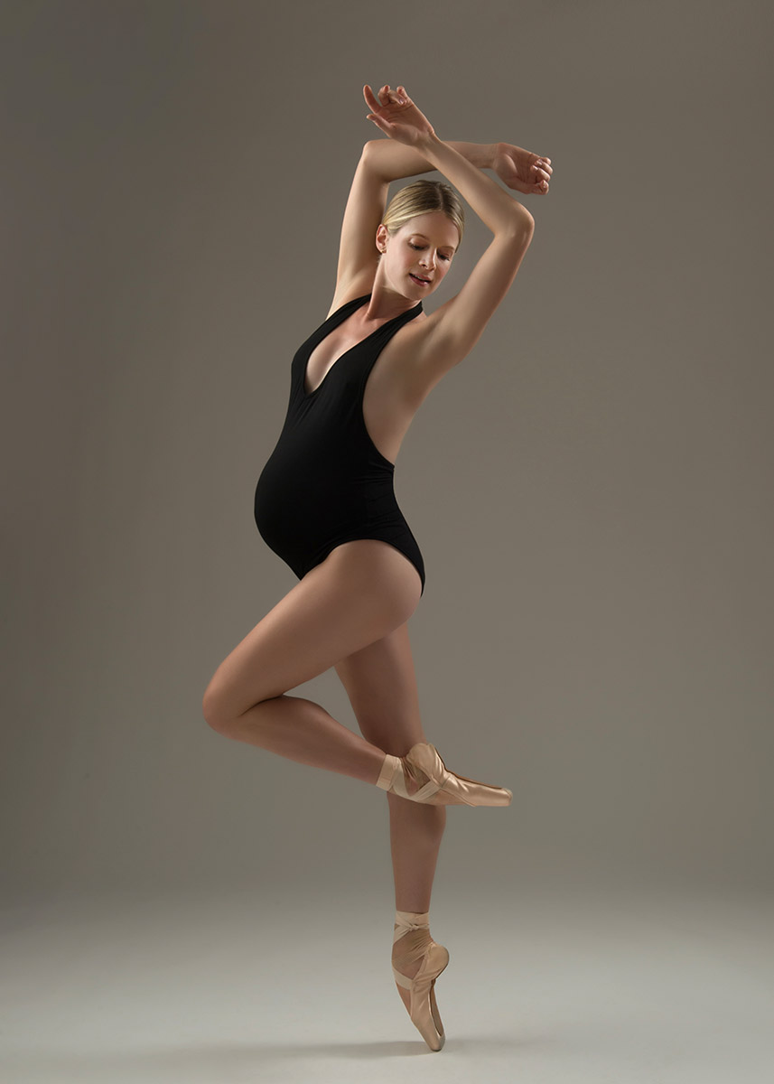 Pregnant ballerina in a black bodysuit