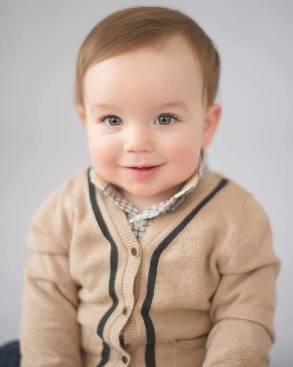 Cute baby portrait of a boy in a sweater