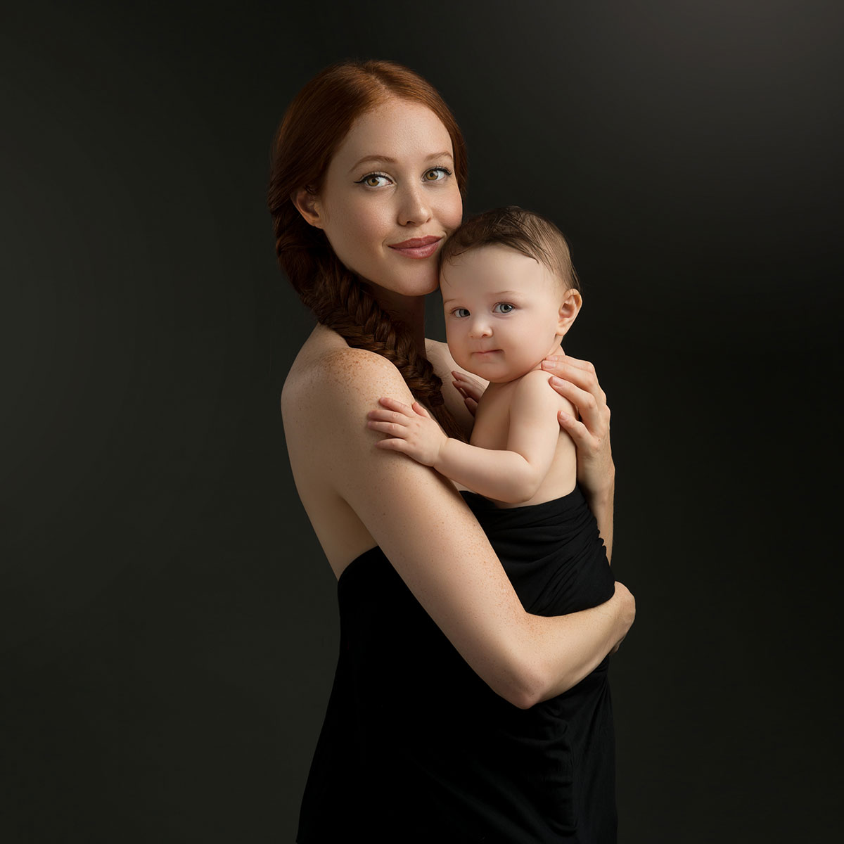 Woman and her baby posing for a photograph in NYC