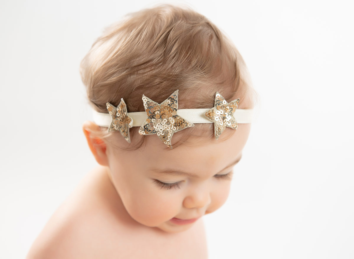 Cute baby wearing a star-themed headband