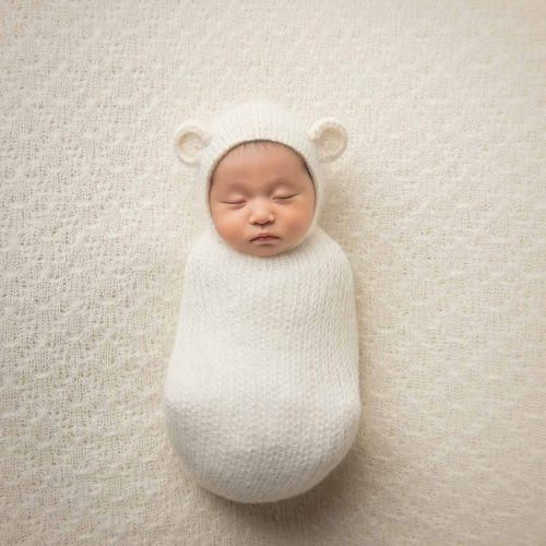 Newborn baby sleeping in a photo studio