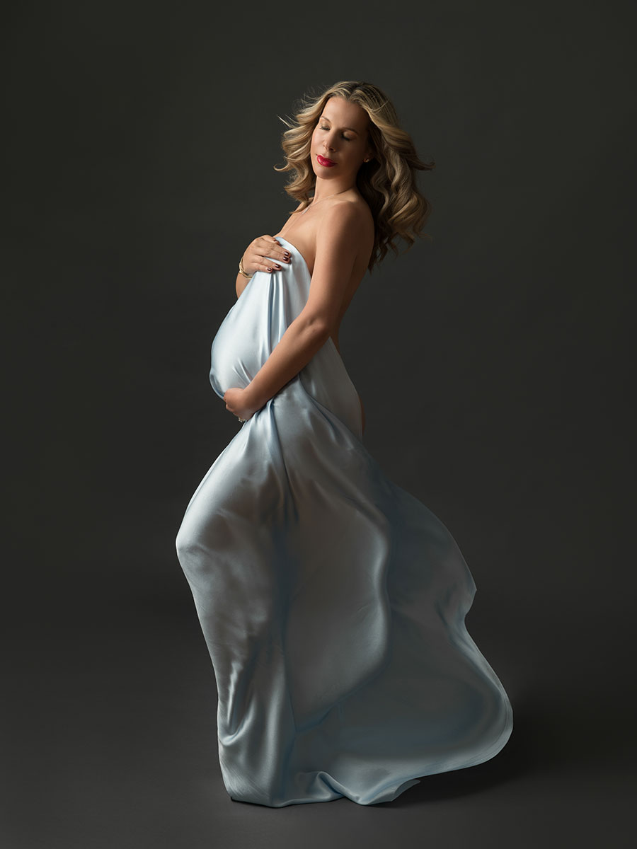Maternity photograph with blue silks