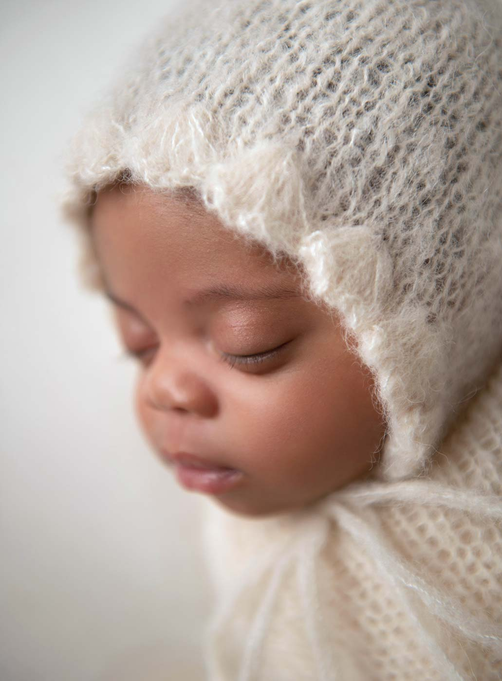 closeup face of infant baby with long lashes and pouty lips