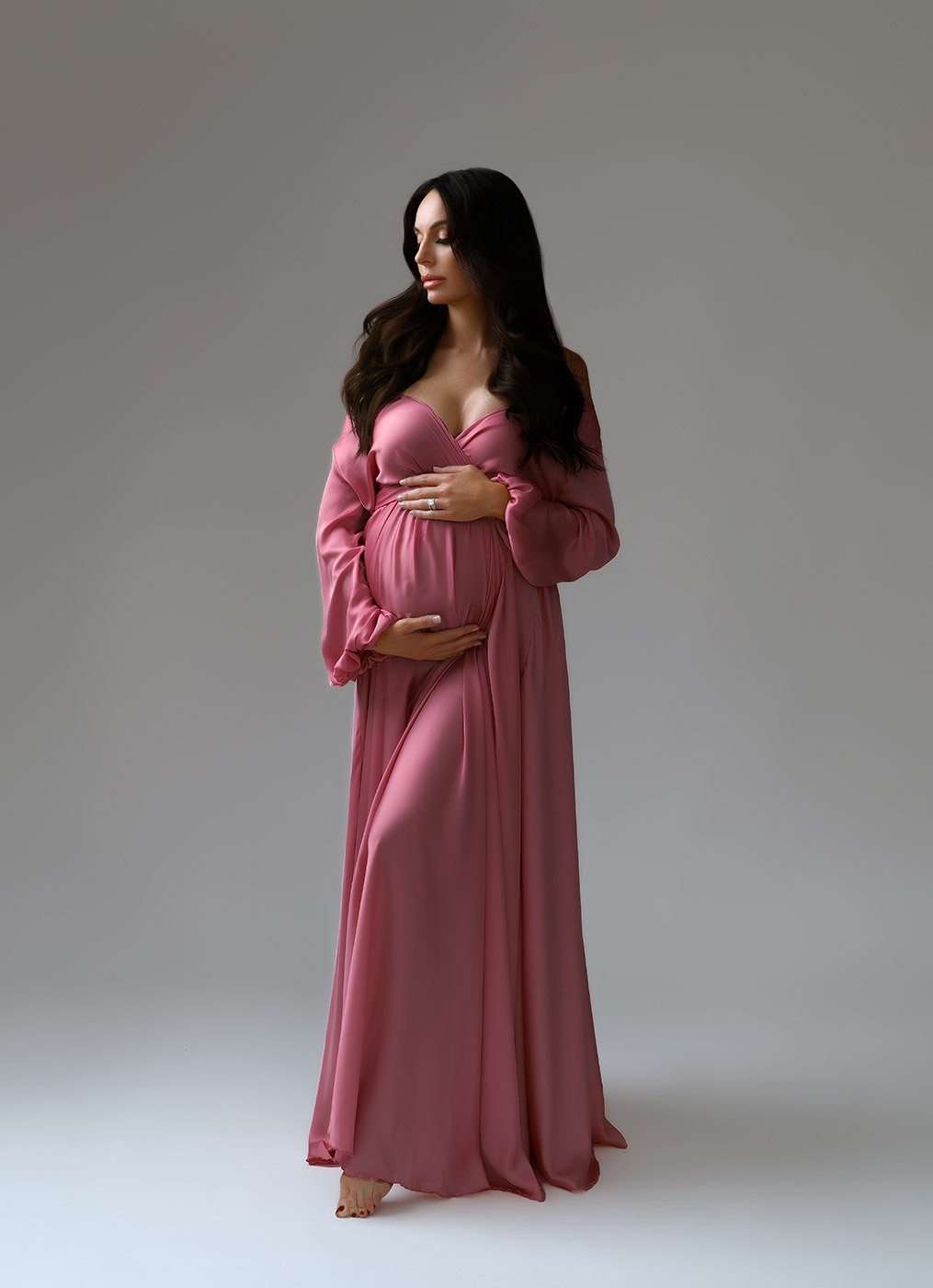 pregnant woman in rose dress captured at nyc maternity photo studio